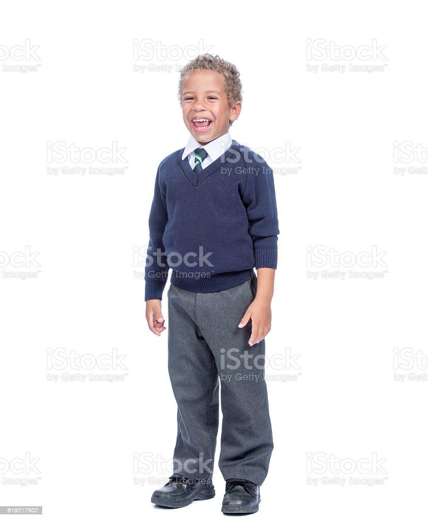 Happy Young Biracial Boy In School Uniform stock photo