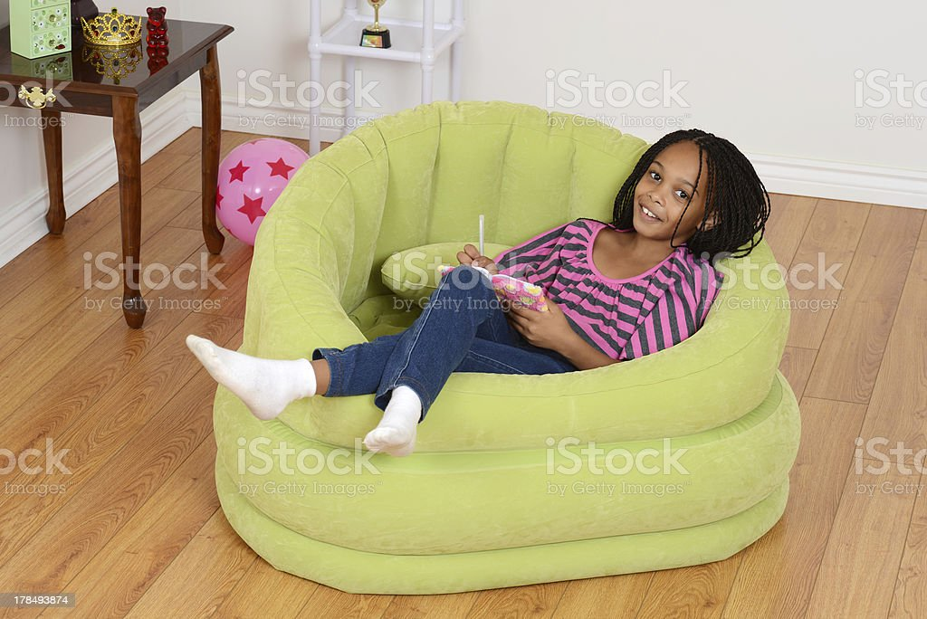 happy young black child relaxing royalty-free stock photo