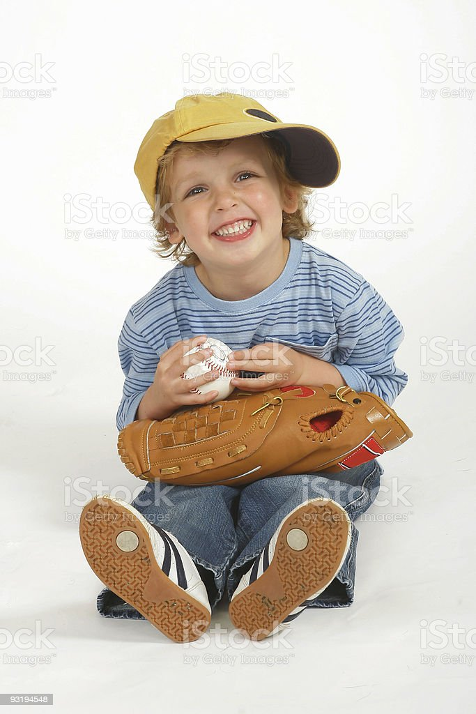 Happy Young Blond Boy Dressed in Oversized Baseball Kit royalty-free stock photo