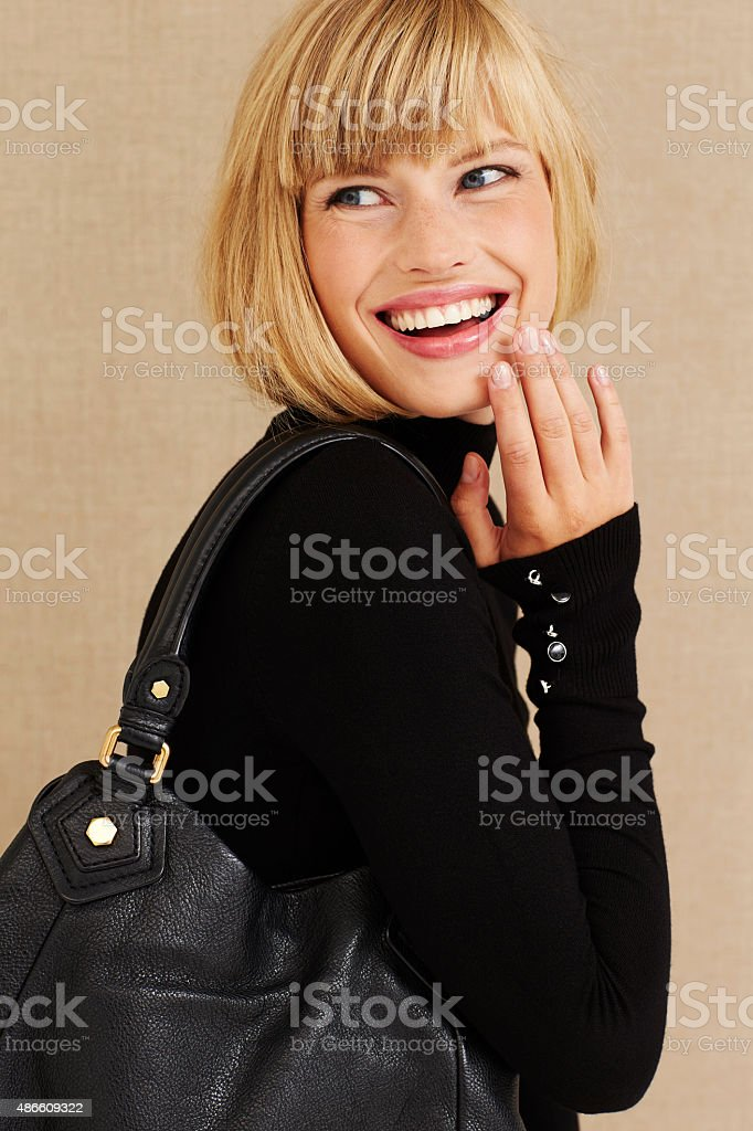 Happy young blond businesswoman stock photo