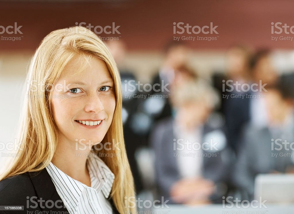 Happy young blond female at a business conference royalty-free stock photo