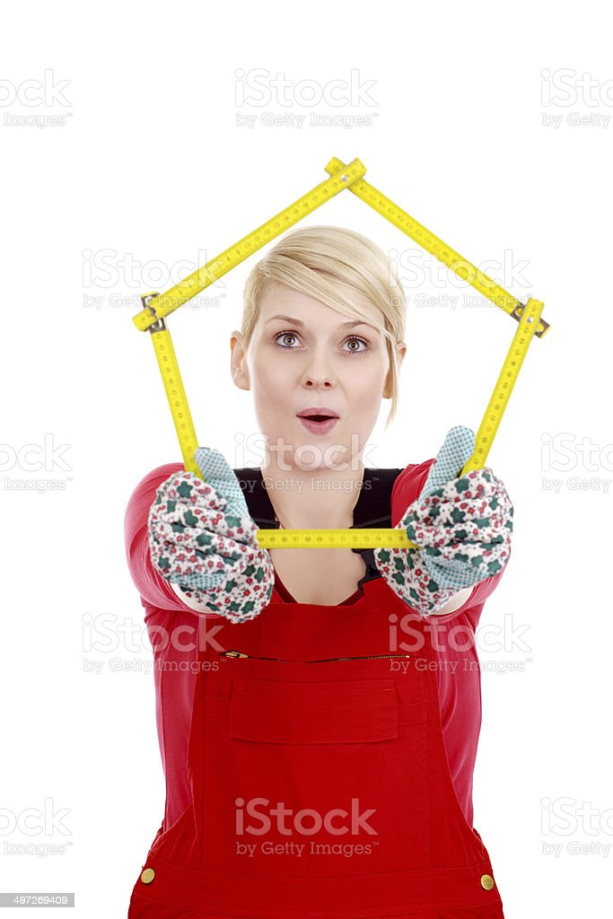 happy young blonde with construction tape measure stock photo