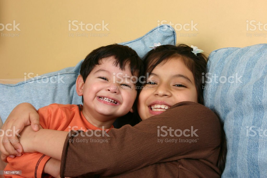 A happy young boy and girl hugging stock photo
