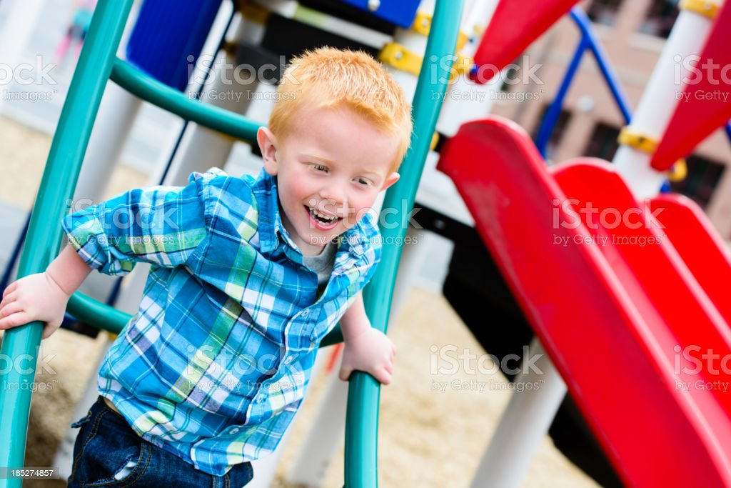 Happy young boy having fun at the playground royalty-free stock photo