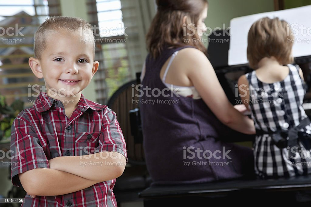 Happy Young Boy In Room During Piano Lessons royalty-free stock photo
