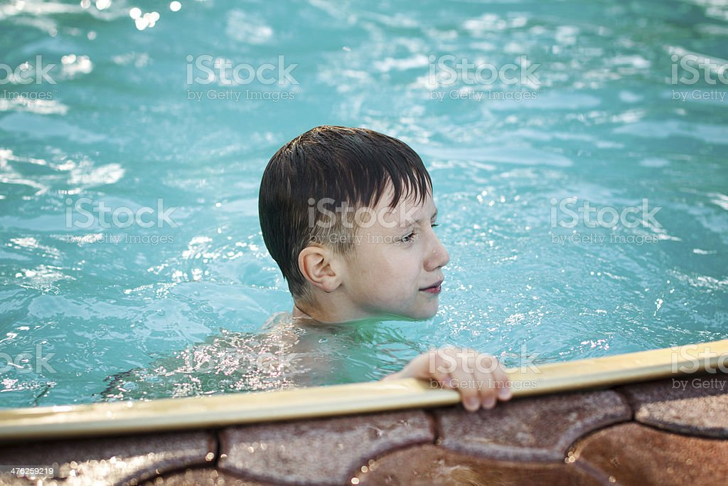 Happy young boy in the pool royalty-free stock photo