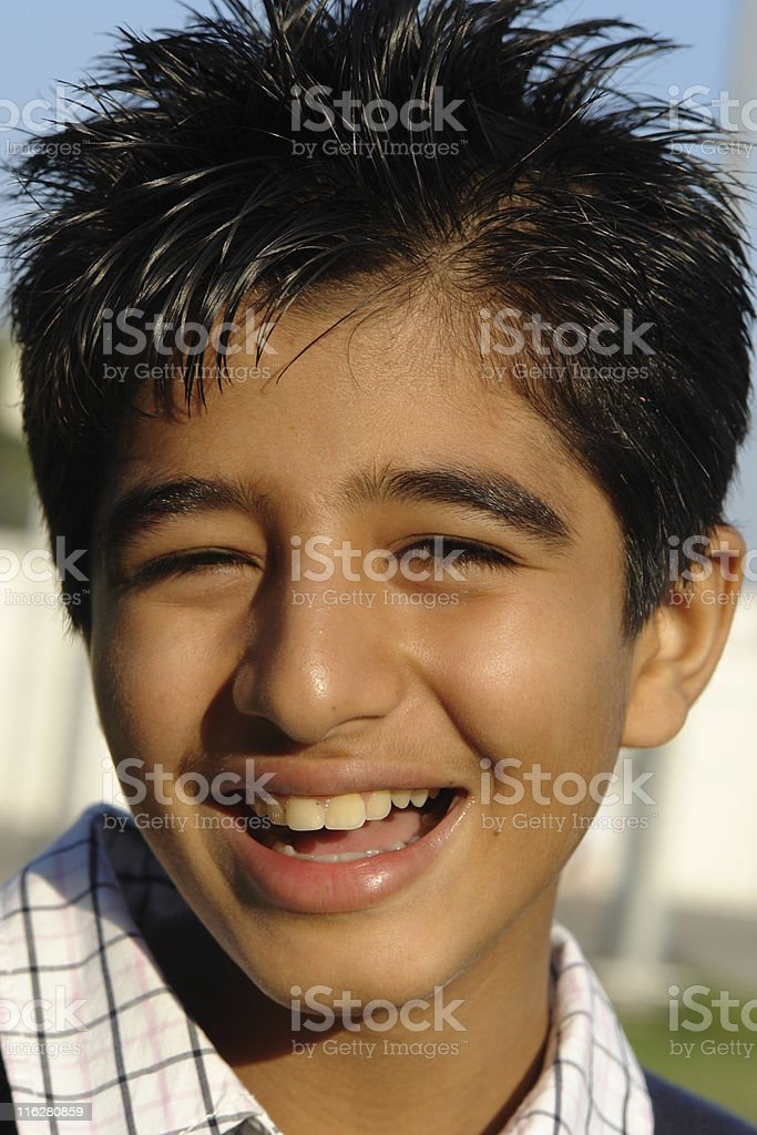 Happy young boy smiling on sunny day royalty-free stock photo