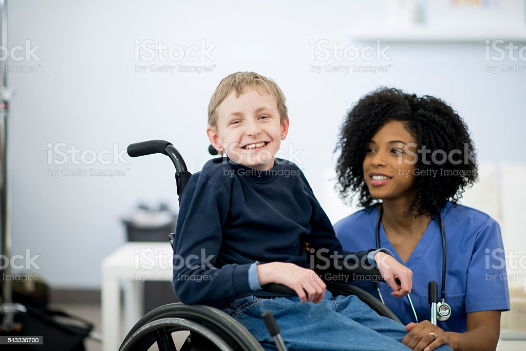 Happy Young Boy with Cerebral Palsy stock photo