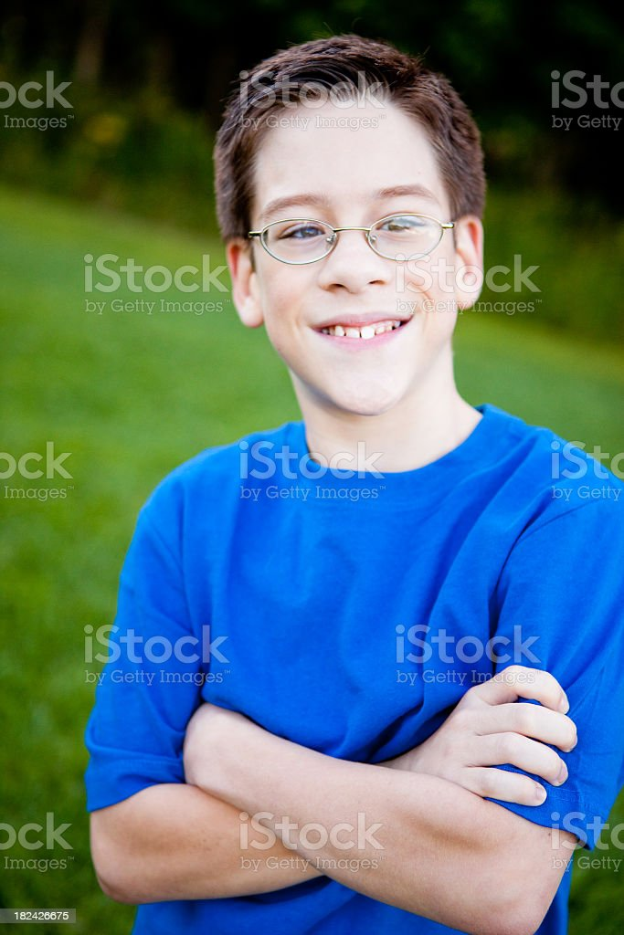 Happy Young Boy with Glasses Smiling Outside royalty-free stock photo
