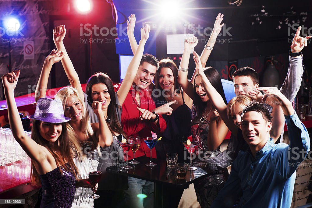 Happy young boys and girls enjoying at a disco. royalty-free stock photo