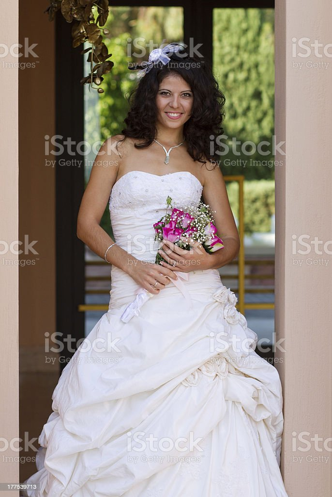 Happy young bride with bouquet royalty-free stock photo