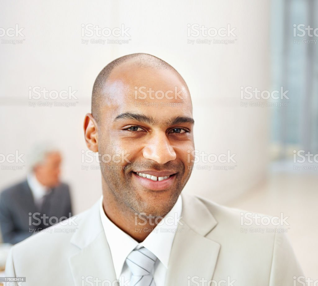Happy young business man smiling royalty-free stock photo