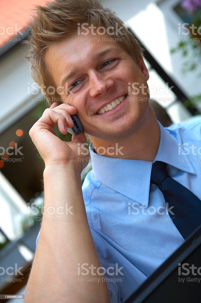 Happy young business man talking on cellphone royalty-free stock photo
