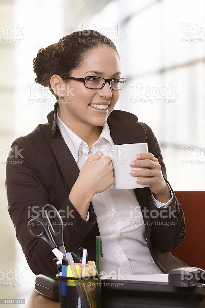 Happy young business woman drinking coffee royalty-free stock photo