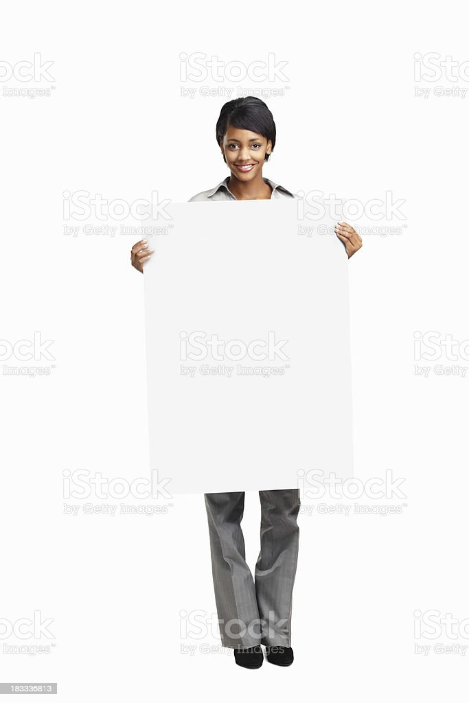 Happy young business woman holding a blank board royalty-free stock photo