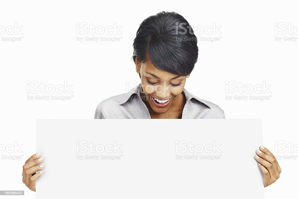 Happy young business woman looking at blank board royalty-free stock photo
