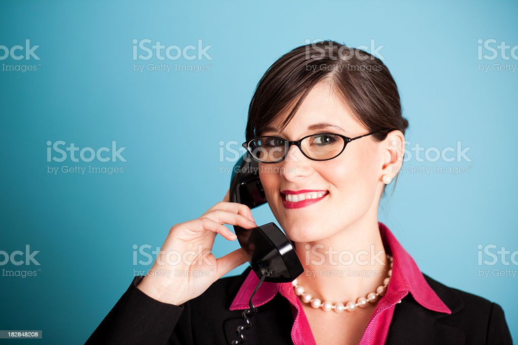 Happy Young Business Woman Smiling on the Phone royalty-free stock photo