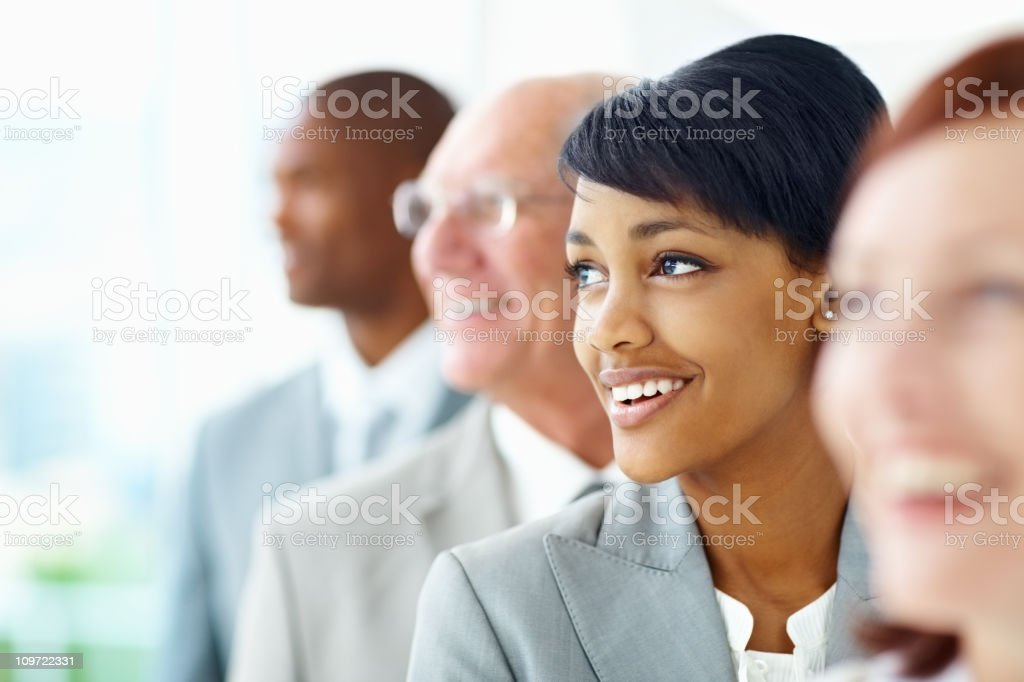 Happy young business woman standing with her blur team royalty-free stock photo