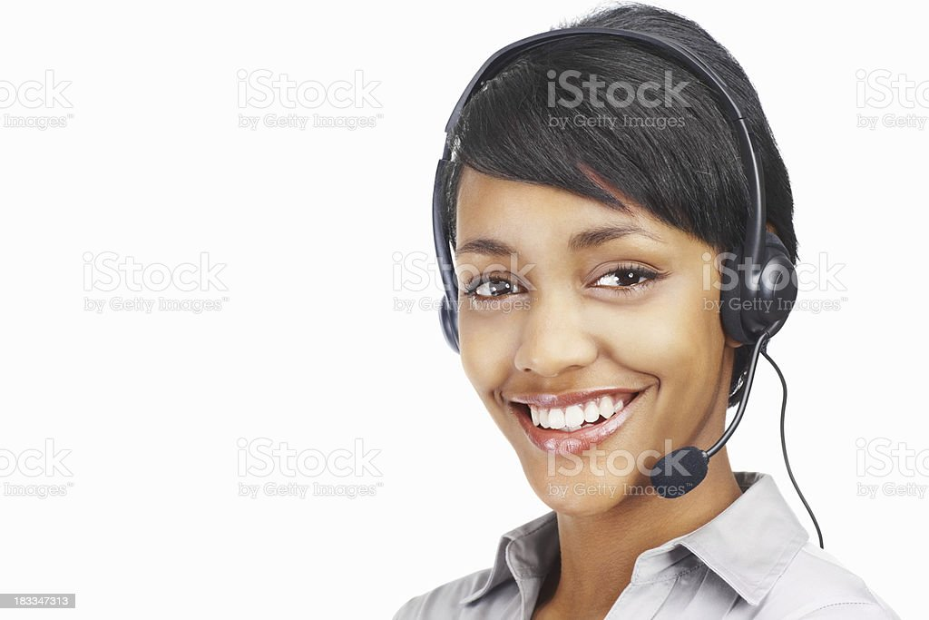 Happy young business woman wearing headset royalty-free stock photo