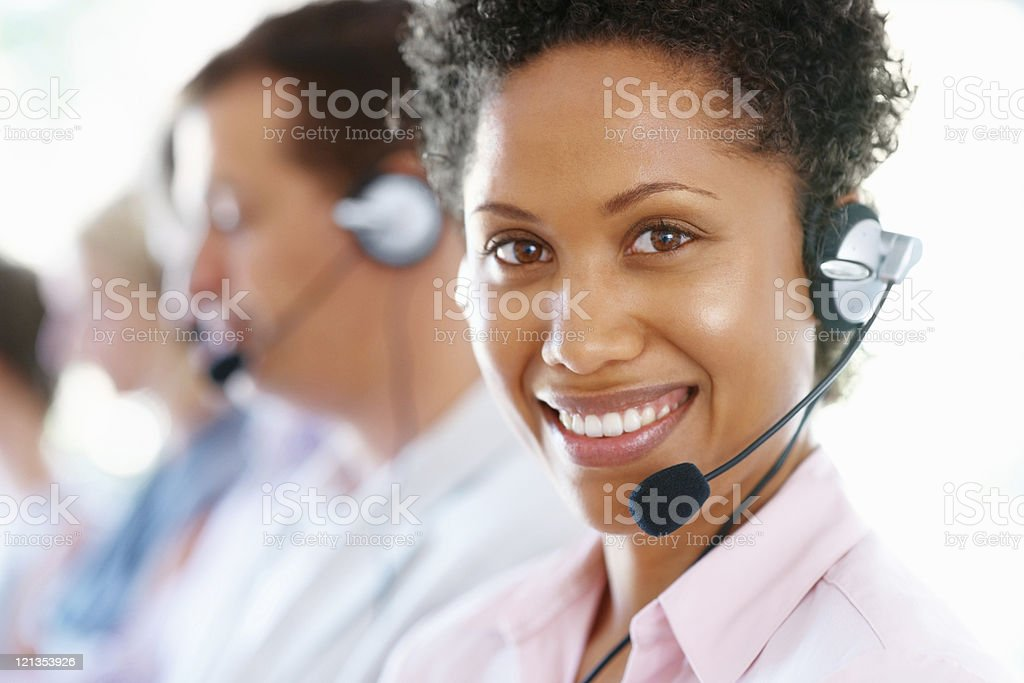 Happy young business woman with headset royalty-free stock photo