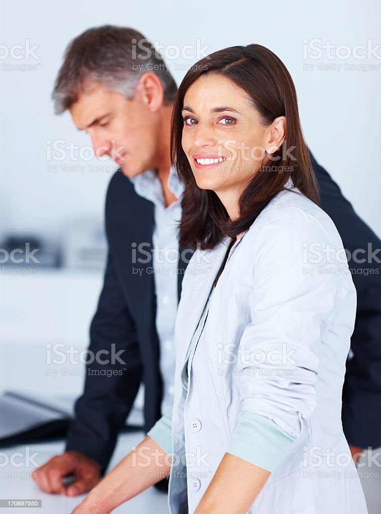 Happy young business woman working with a colleague stock photo