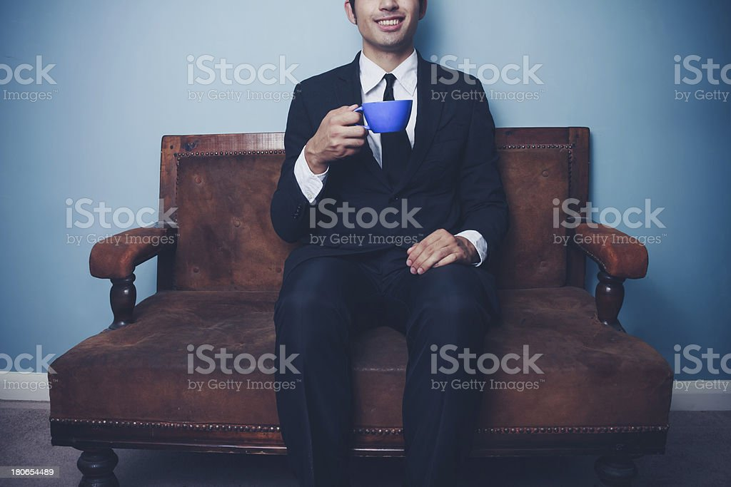 Happy young businessman drinking coffee royalty-free stock photo