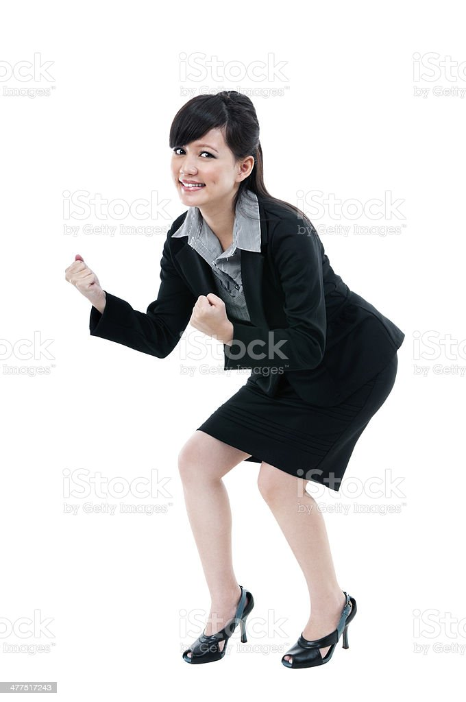 Happy Young Businesswoman Cheering stock photo