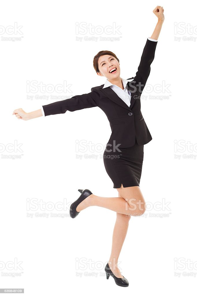 happy young businesswoman jumping and dancing stock photo