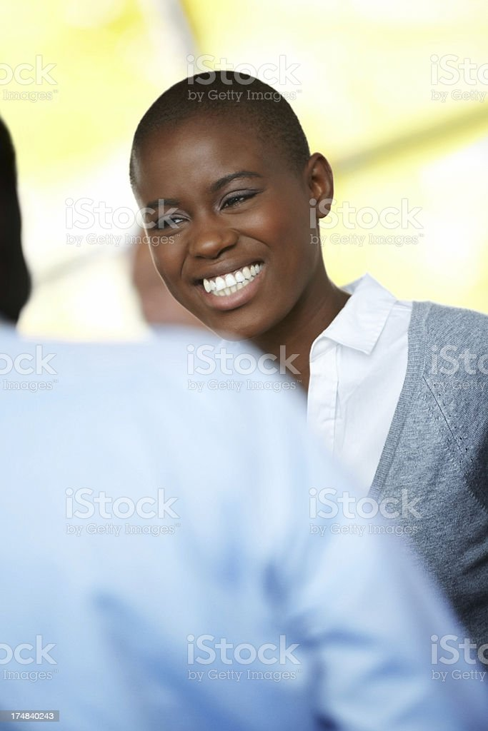 Happy young businesswoman surrounded by team member royalty-free stock photo
