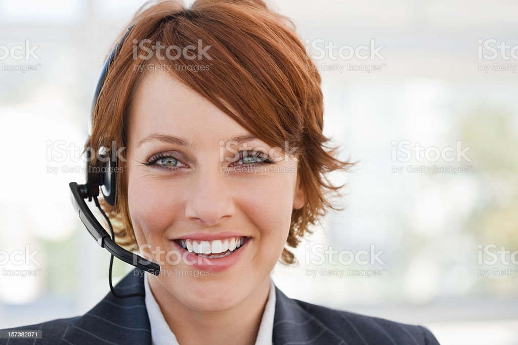 Happy young businesswoman with headset royalty-free stock photo