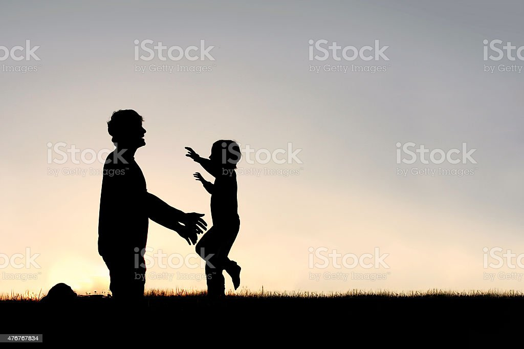 Happy Young Child Running to Greet Dad Silhouette stock photo