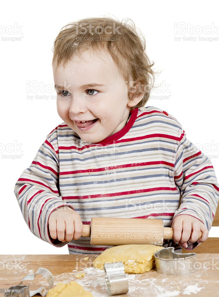 happy young child working with dough in white background stock photo