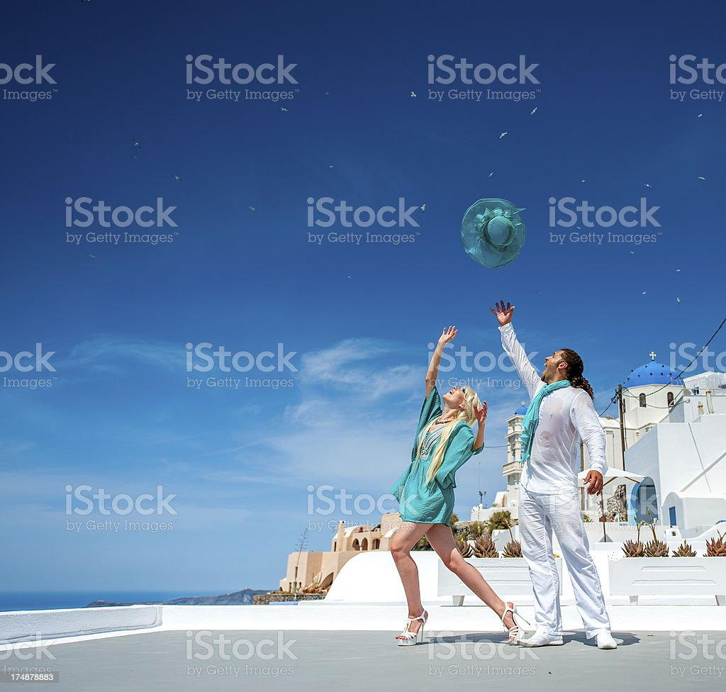Happy young couple and hat royalty-free stock photo