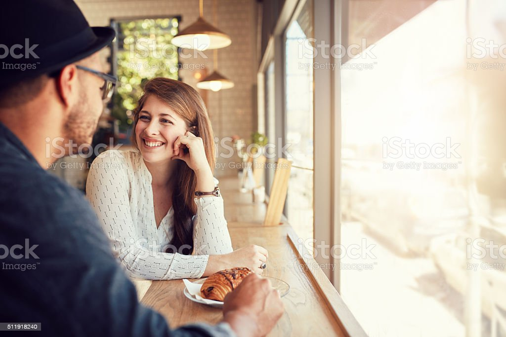 Happy young couple at coffee shop stock photo
