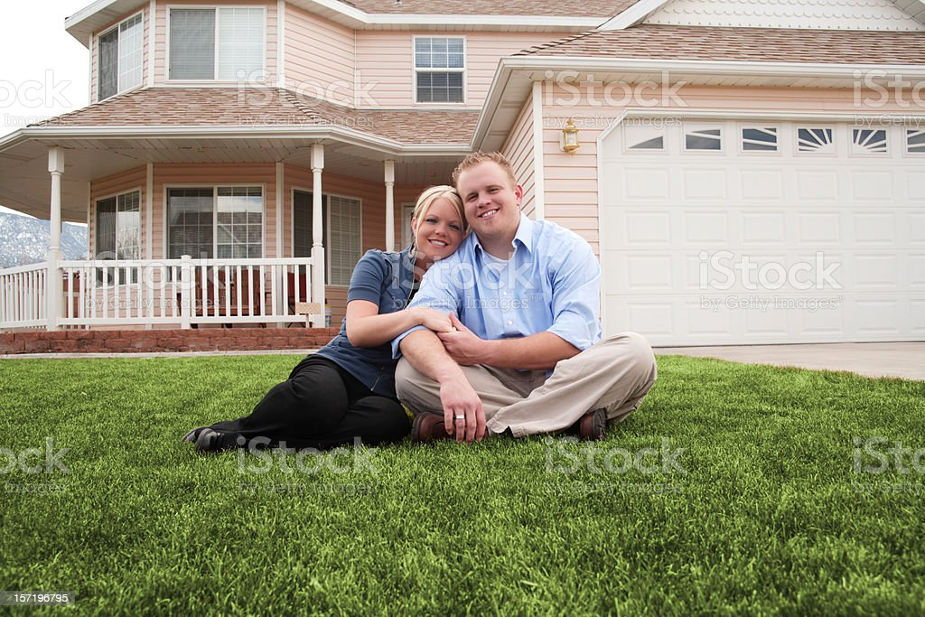 Happy Young Couple at Home in Front Yard royalty-free stock photo