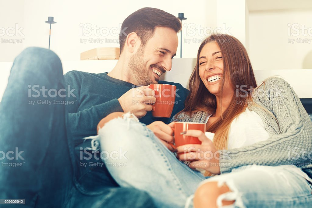 Happy young couple at home stock photo