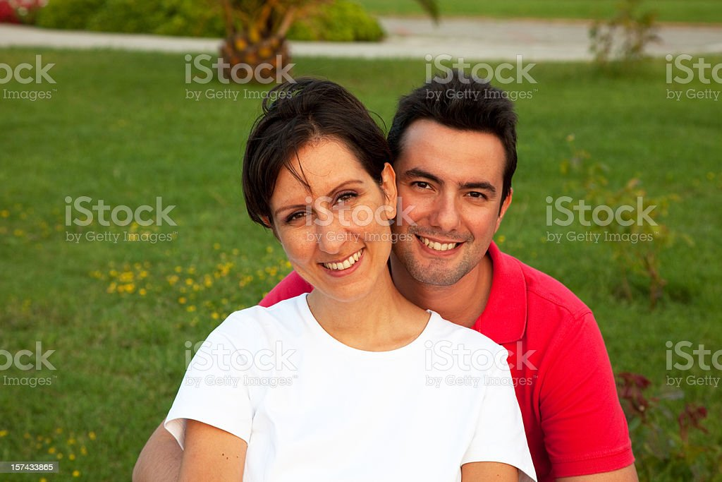 Happy young couple at sunset light royalty-free stock photo