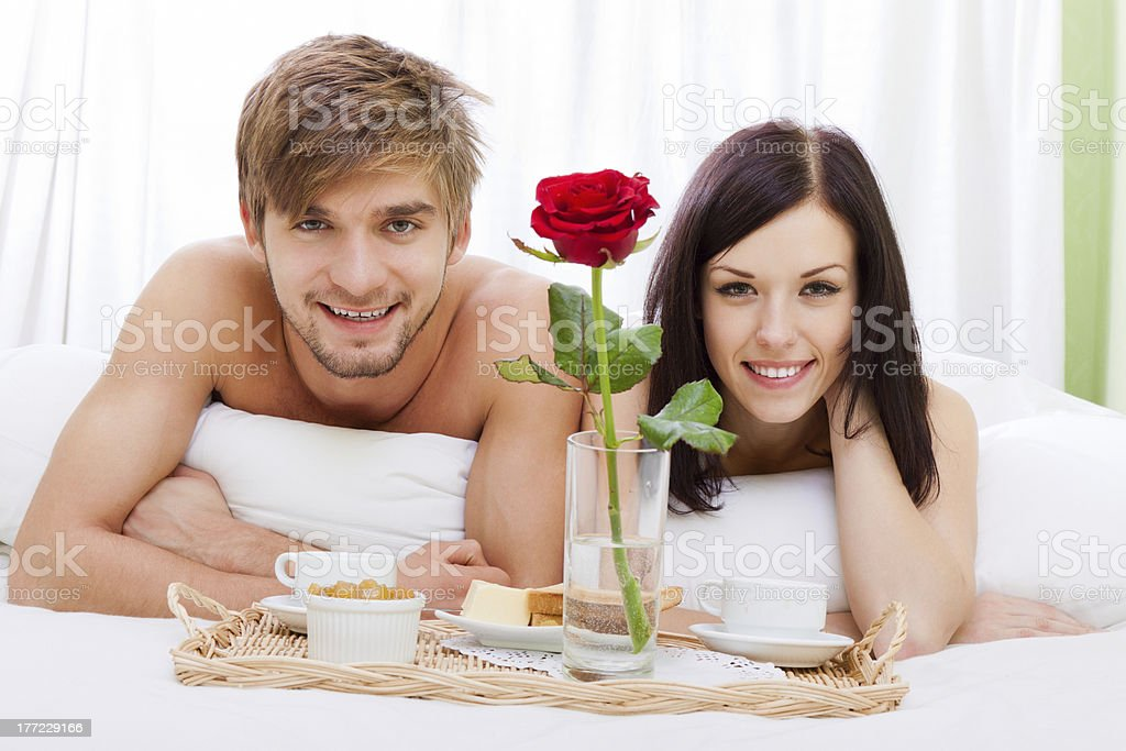 happy young couple breakfast in bed royalty-free stock photo