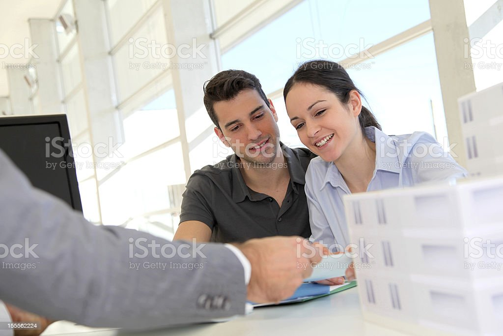 Happy young couple buying new house stock photo