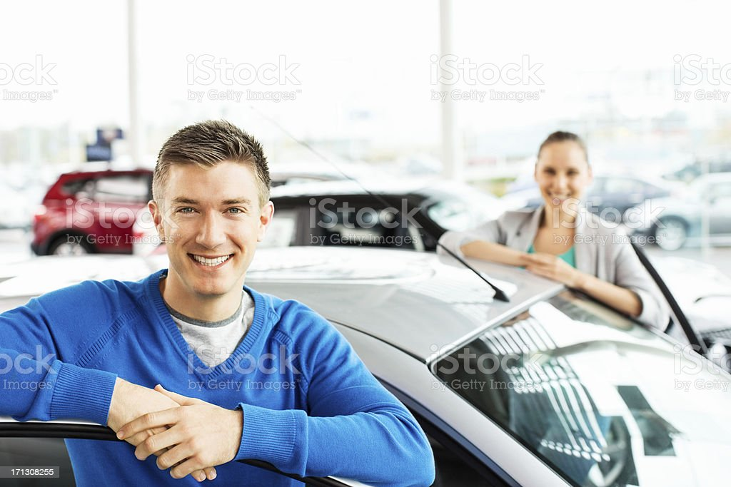 Happy Young Couple By New Car royalty-free stock photo