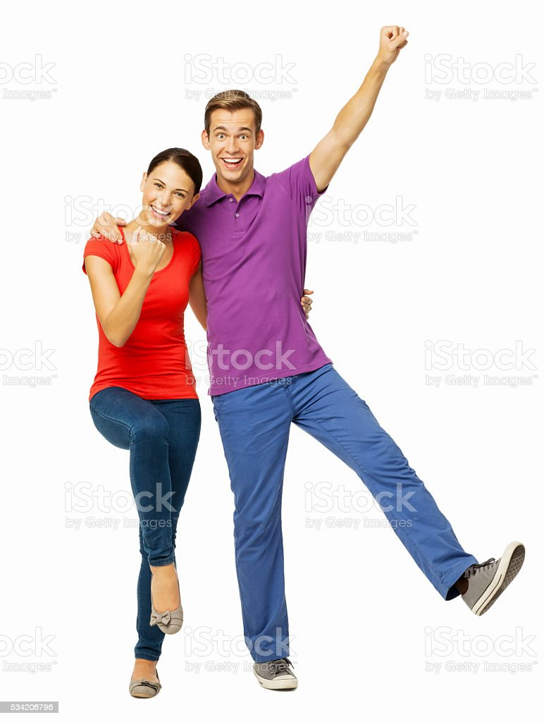 Happy Young Couple Cheering With Joy stock photo