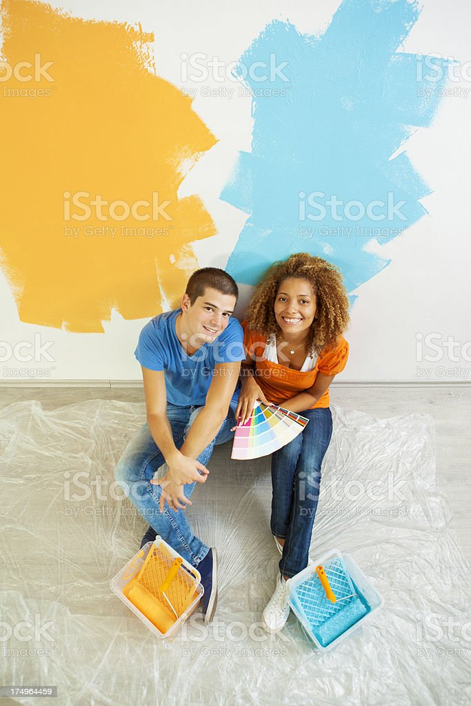 Happy Young Couple Choosing Paint Color for Their Home. royalty-free stock photo