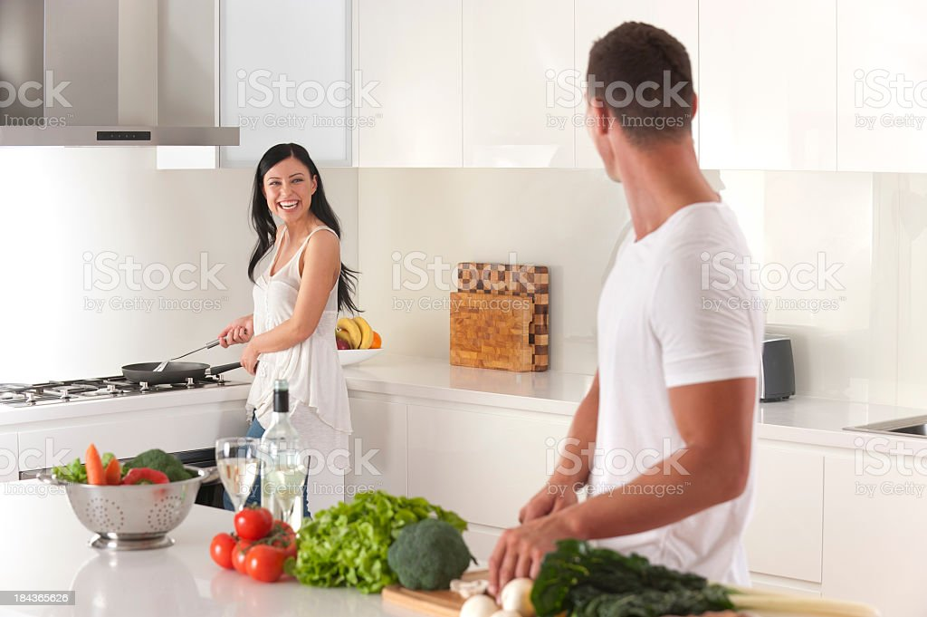 Happy young couple cooking royalty-free stock photo