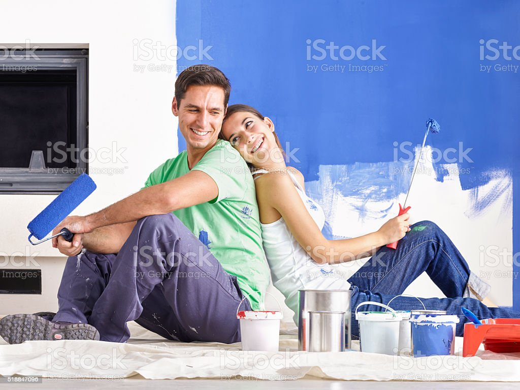 Happy Young Couple Decorating New Home stock photo
