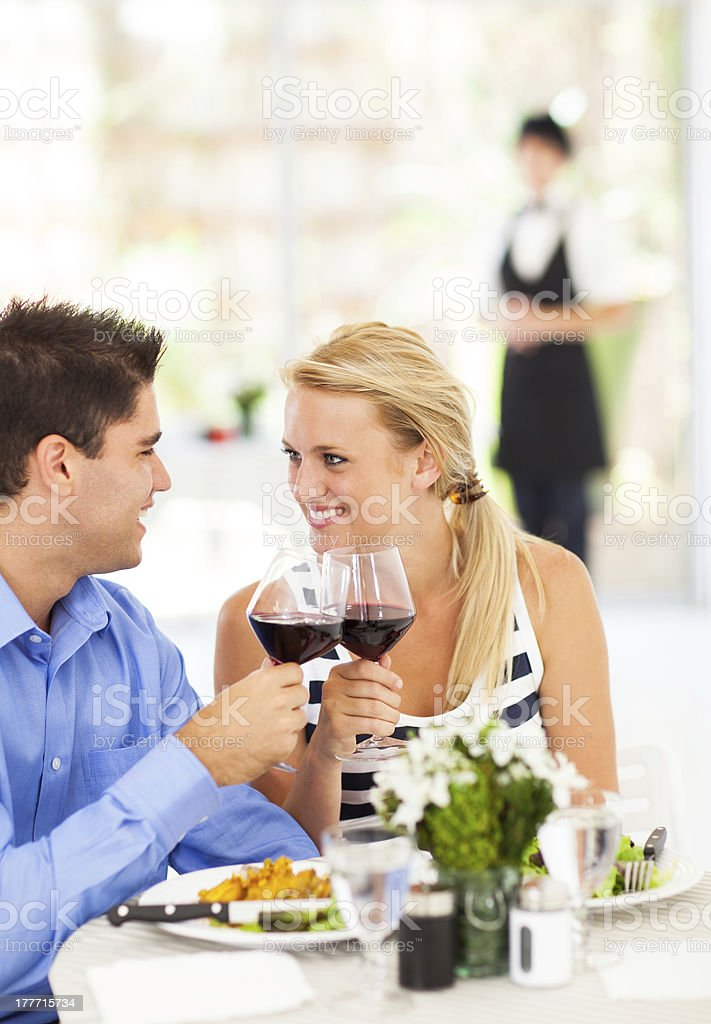 happy young couple eating out royalty-free stock photo