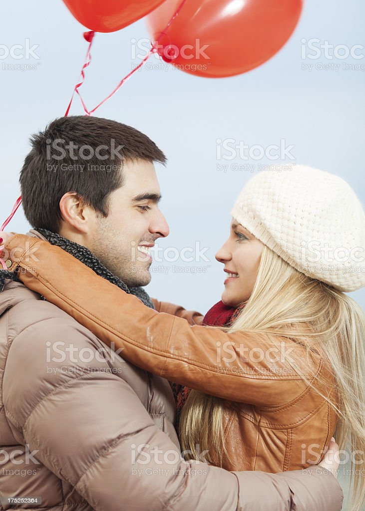 Happy young couple embracing outdoors royalty-free stock photo