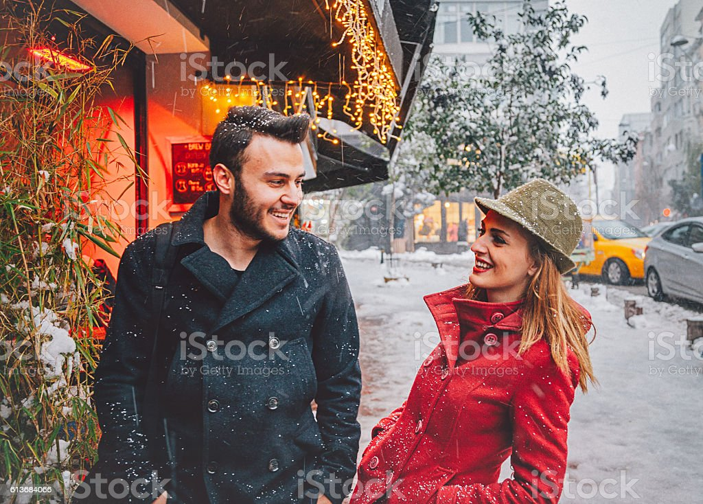 Happy young couple enjoying outdoor in snowy winter time stock photo
