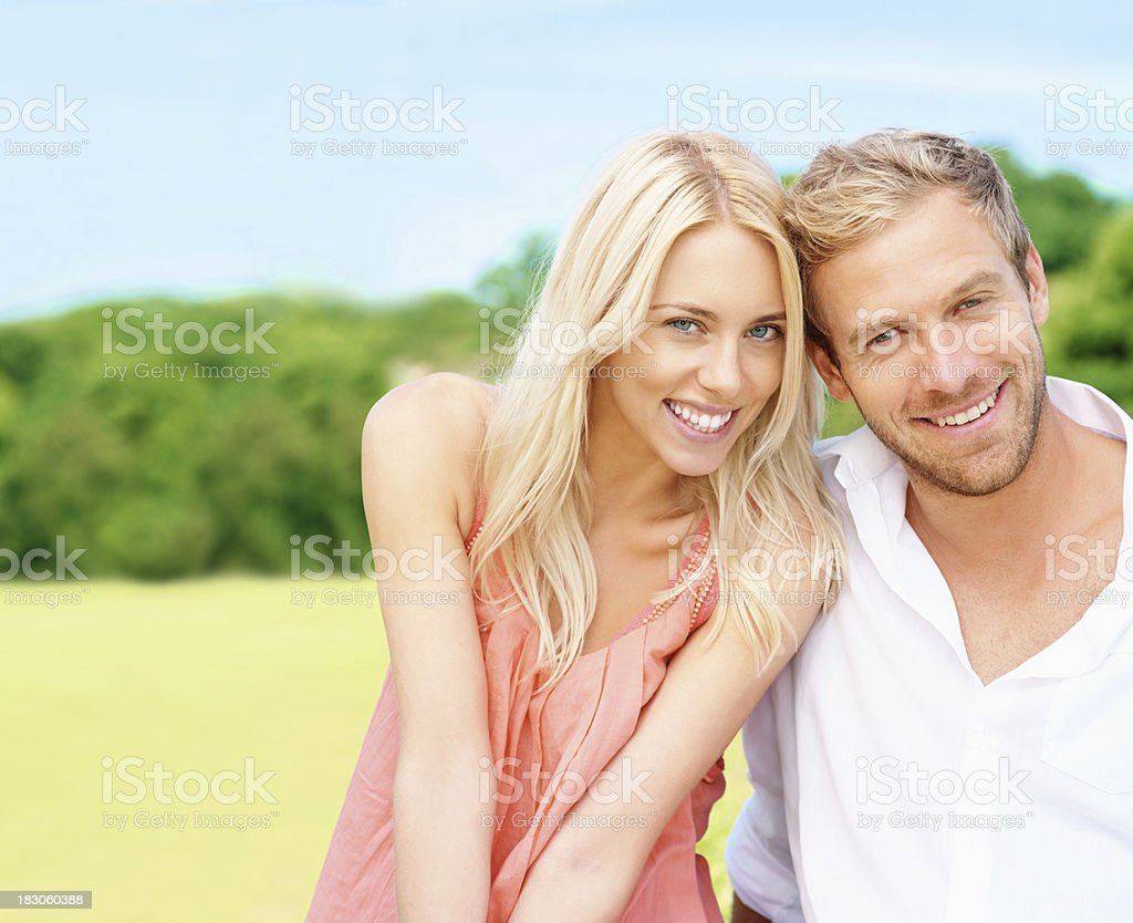 Happy young couple enjoying their vacation in a park royalty-free stock photo