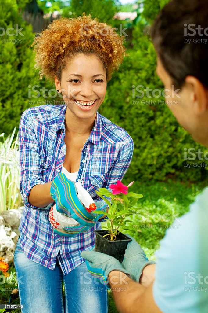 Happy Young Couple Gardening Outdoors. royalty-free stock photo