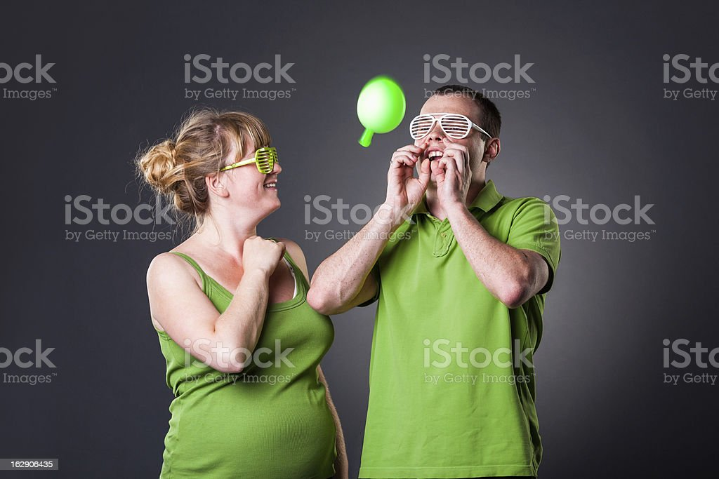 Happy young couple having fun with balloons royalty-free stock photo